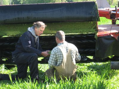 Tom Kilcer helping a farmer